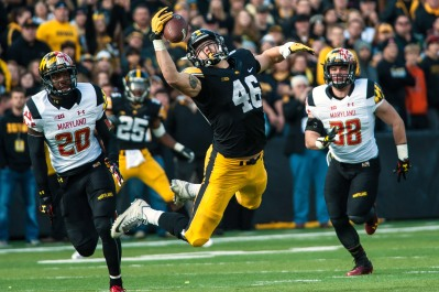 Oct 31, 2015; Iowa City, IA, USA; Iowa Hawkeyes tight end George Kittle (46) reaches out to catch a pass while chased by by Maryland Terrapins defensive back Anthony Nixon (20) and linebacker Brett Zanotto (38) during the first quarter against the Maryland Terrapins at Kinnick Stadium. Mandatory Credit: Jeffrey Becker-USA TODAY Sports