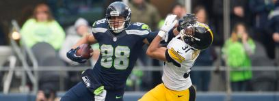 Seattle tight end Jimmy Graham fights off Pittsburgh's Ross Cockrell for an 18-yard gain and a first down.