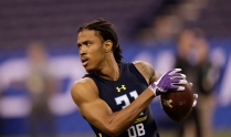 Washington defensive back Kevin King runs a drill at the NFL football scouting combine Monday, March 6, 2017, in Indianapolis. (AP Photo/David J. Phillip)