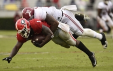 Oct 3, 2015; Athens, GA, USA; Georgia Bulldogs running back Sony Michel (1) is tackled by Alabama Crimson Tide linebacker Reuben Foster (10) during the second quarter at Sanford Stadium. Mandatory Credit: Dale Zanine-USA TODAY Sports
