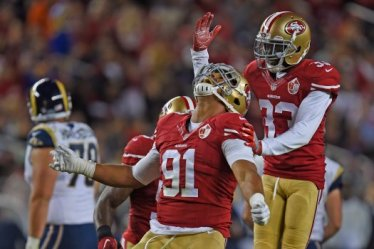 San Francisco 49ers' Arik Armstead (91) is congratulated by teammate San Francisco 49ers' Rashard Robinson (33) after tackling Los Angeles Rams' Case Keenum (17) in the second quarter of their NFL game at Levi's Stadium in Santa Clara, Calif., on Monday, Sept. 12, 2016. (Jose Carlos Fajardo/Bay Area News Group)